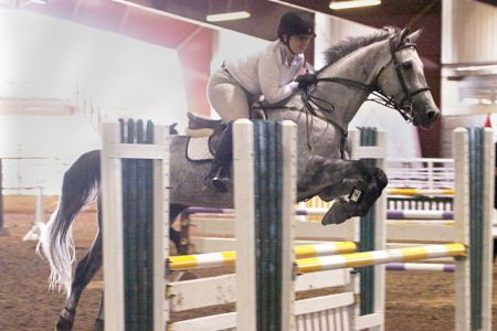 Anwar clearing an oxer beautifully